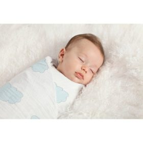 baby swaddled in organic swaddle by aden anais
