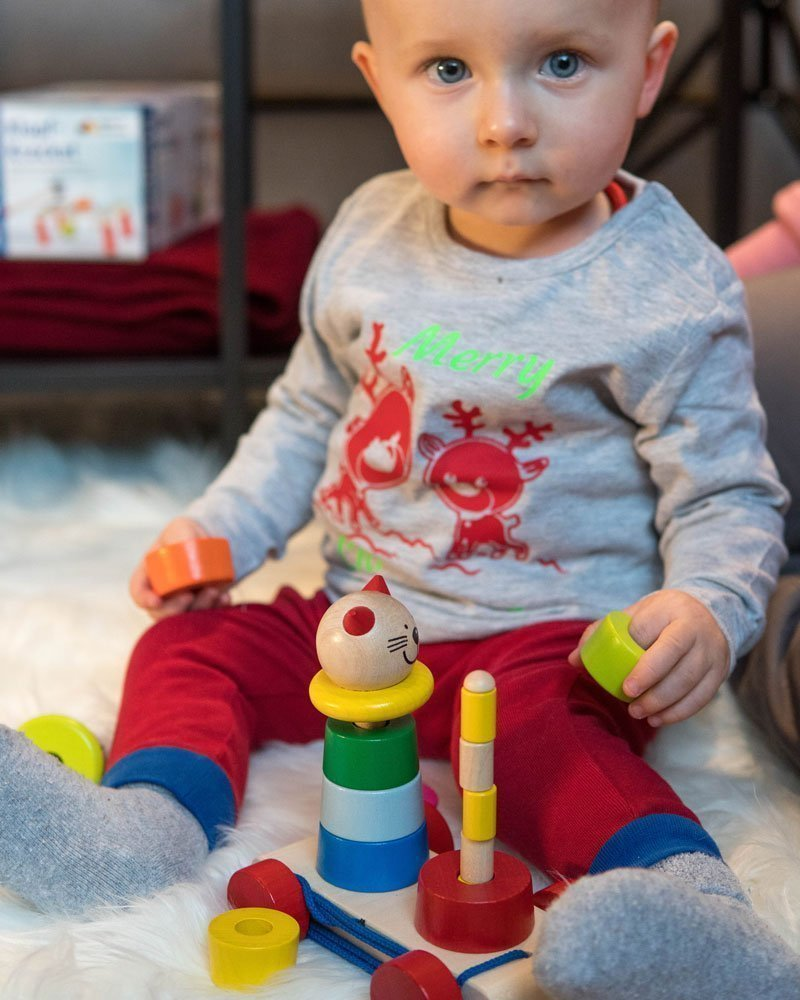 Young child learning to stack a toy