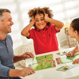 Family playing Orchard Toys board game