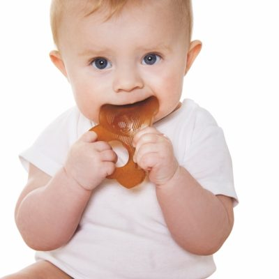 Baby using hevea teether toy