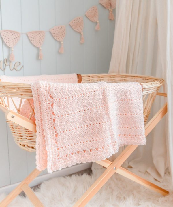 Beautiful handmade peach coloured baby blanket