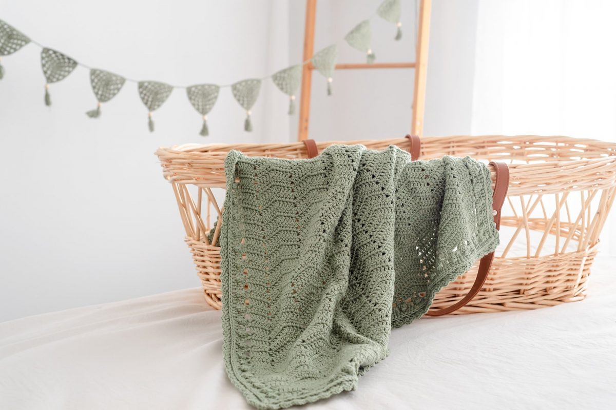 soft and stretchy baby blanket over basinet
