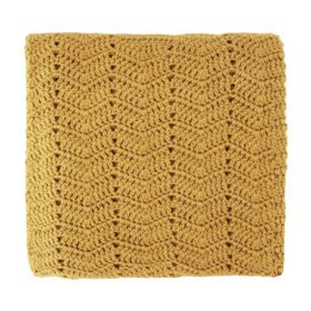 photo of natural fibre blanket in turmeric colour
