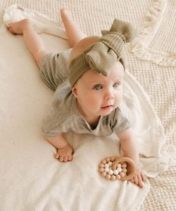 baby with teething toy
