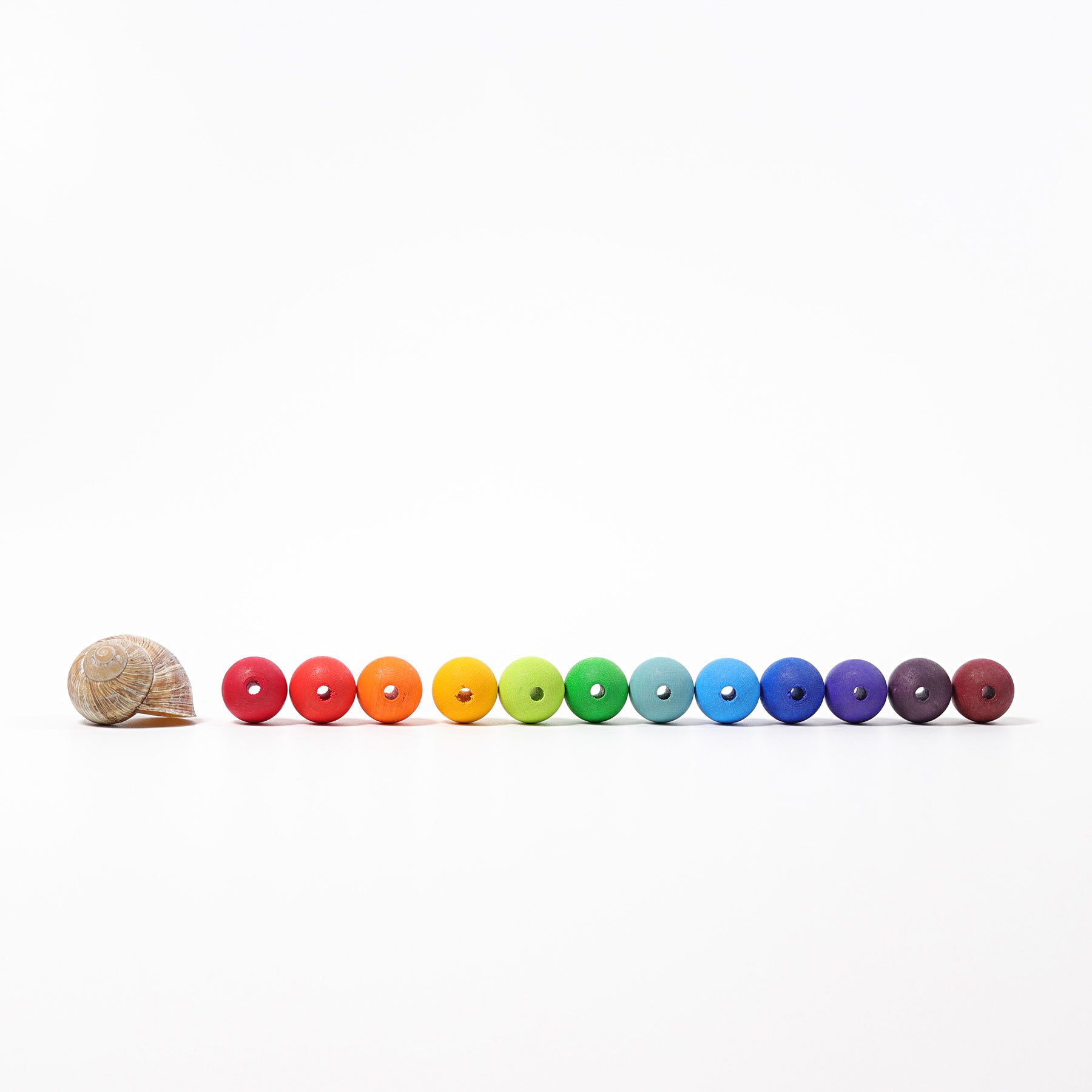 wooden beads by Grimms Spiel & Holz