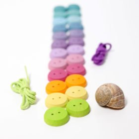 Steiner wooden threading buttons by Grimms.