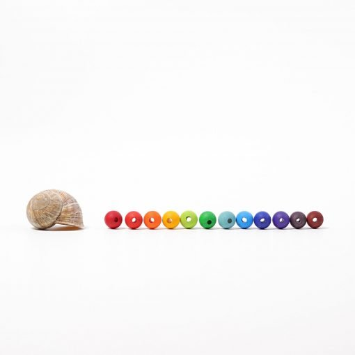 threading wooden beads by Grimms