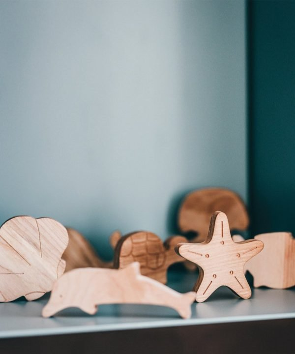 wooden sea animals on shelf