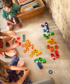 children sorting colourful toy pieces