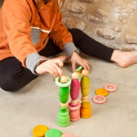 child playing with wooden spring set