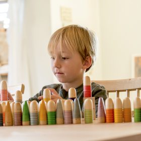 child sorting wooden toys