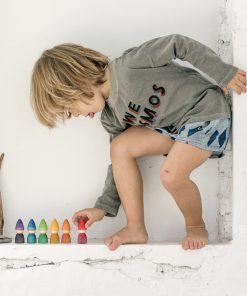 boy playing wooden Tomtens